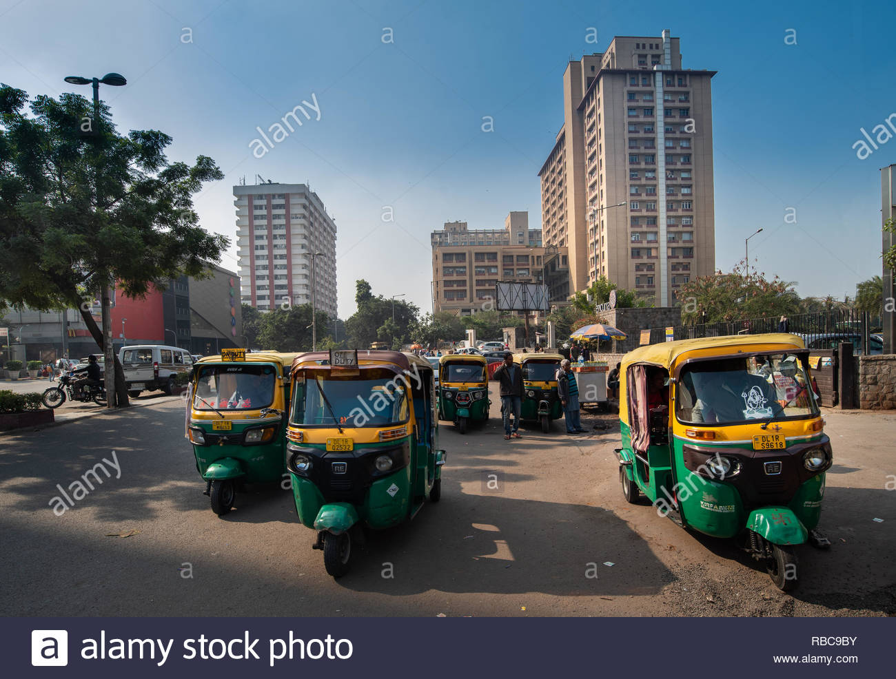 Auto rickshaws waiting for customers near Nehru Place Metro 1300x986
