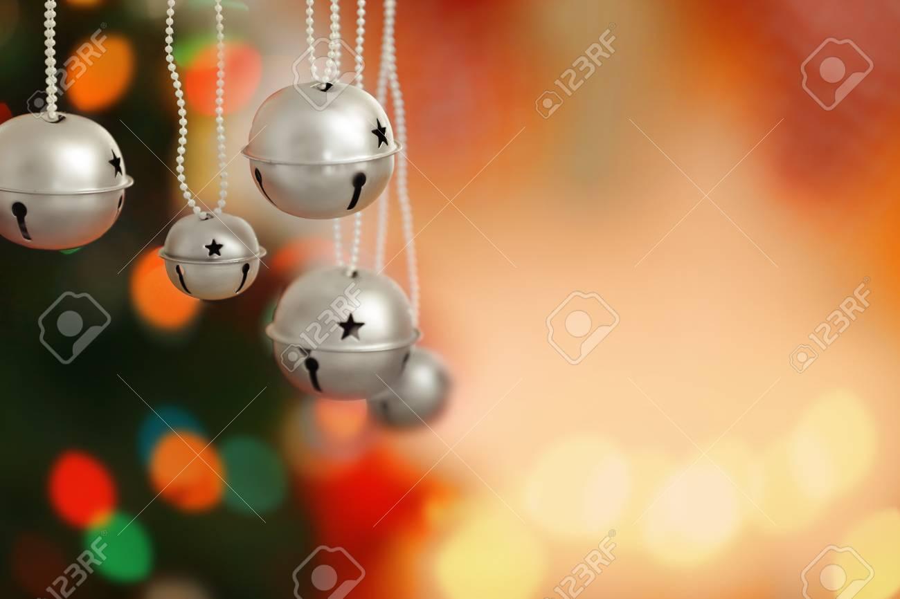 Jingle Bells On Blurred Christmas Lights Background Closeup Stock 1300x866