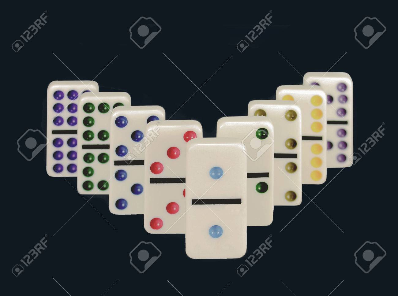 Close up Of Dominos With Colorful Dots Isolated On A Black 1300x968