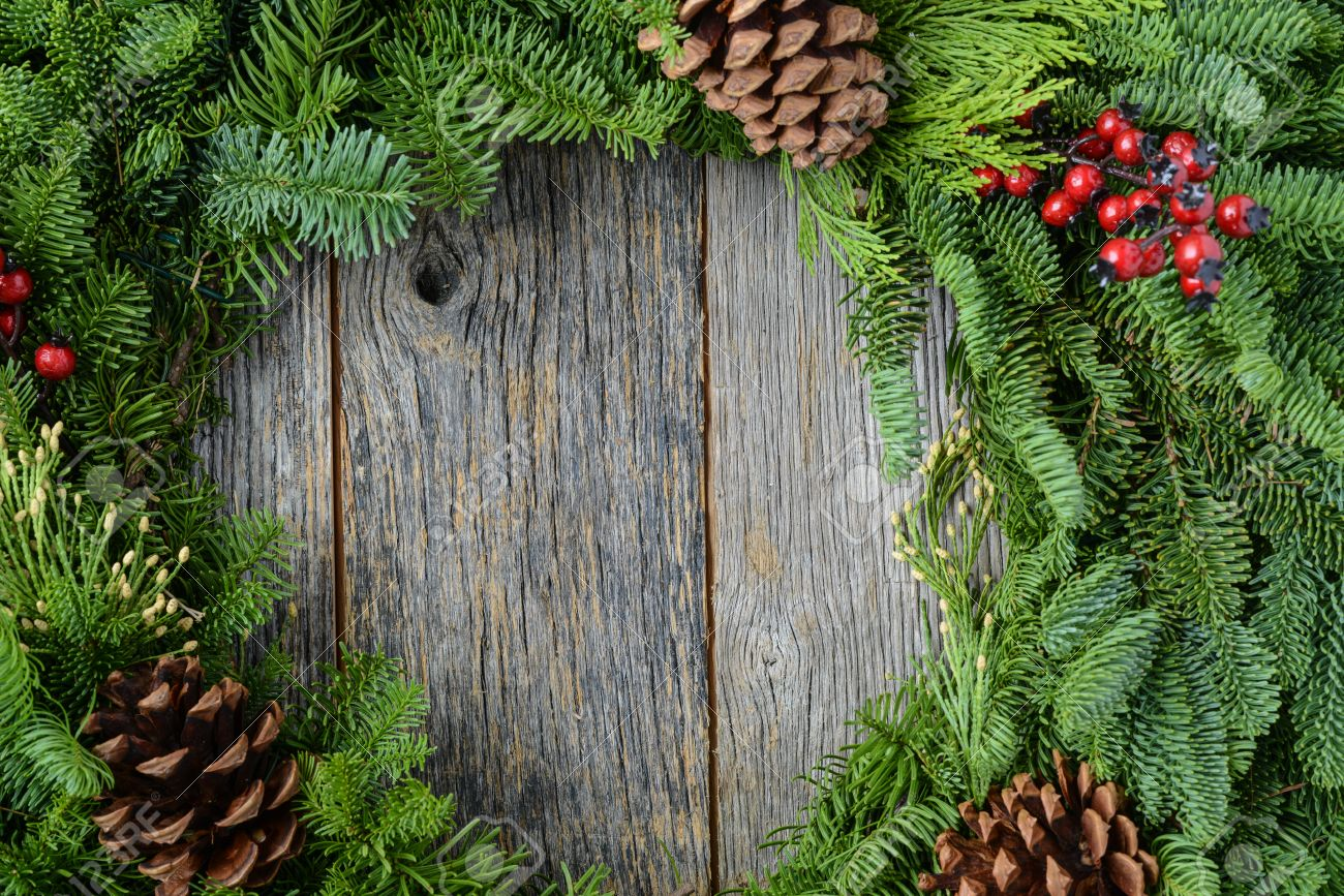 Christmas Wreath With Rustic Wood Background Stock Photo Picture 1300x867