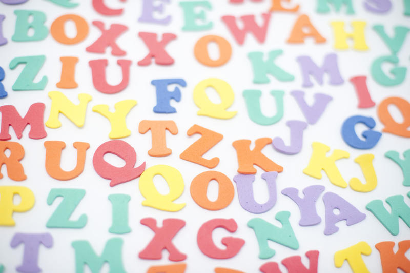 Colourful alphabet background with random scattered uppercase letters 800x532
