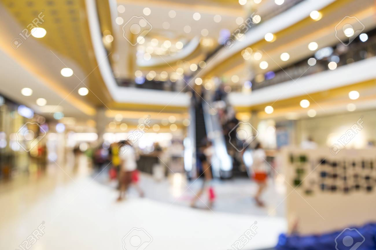 Abstract Blurry Inside Shopping Mall Background Stock Photo 1300x866