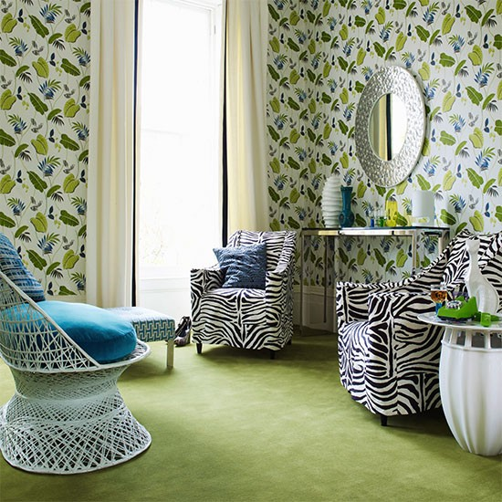 leaf print wallpaper green carpet and zebra print upholstered chairs 550x550
