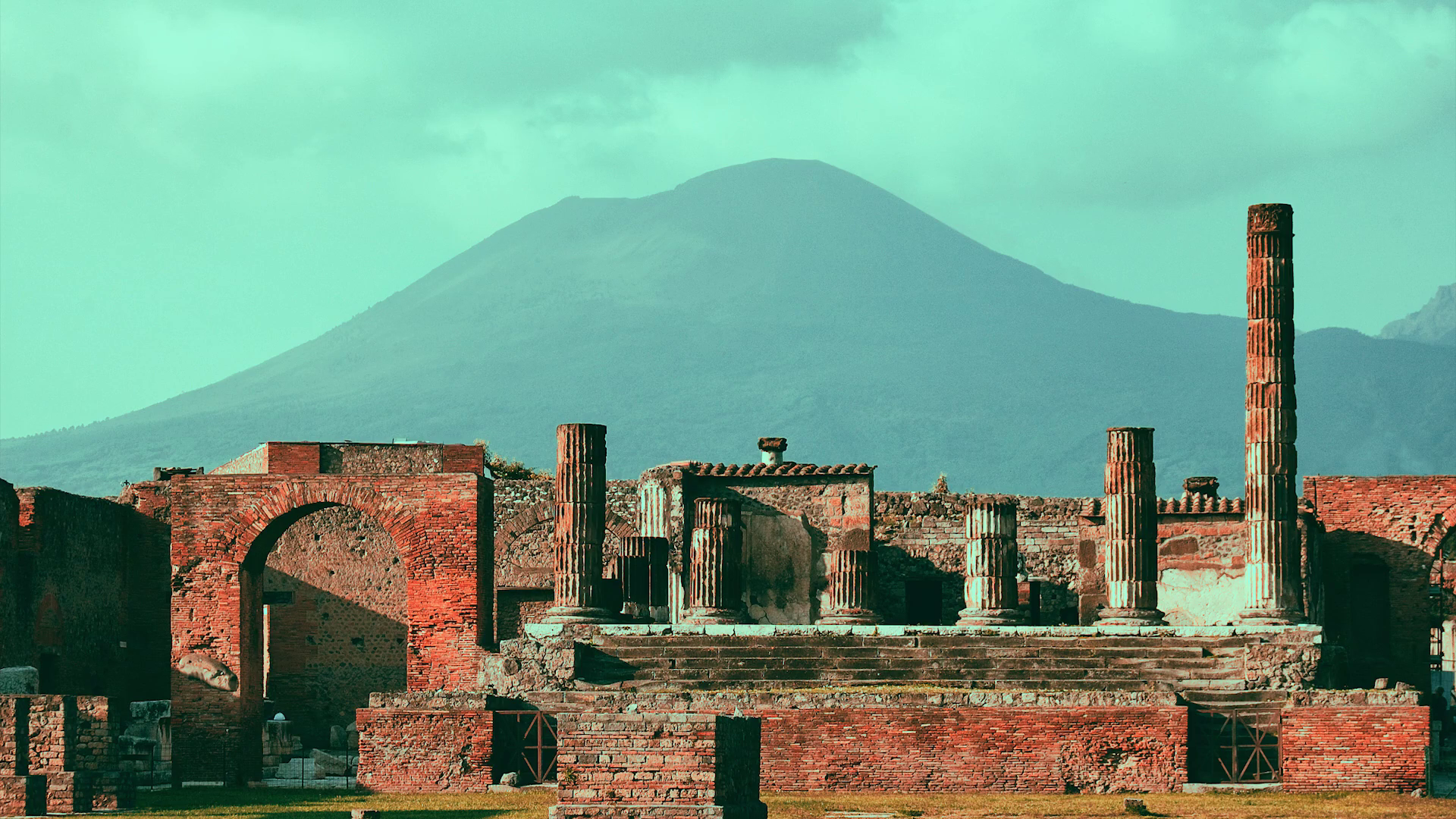 Ancient ruins of Pompeii in the background view of the volcano 1920x1080