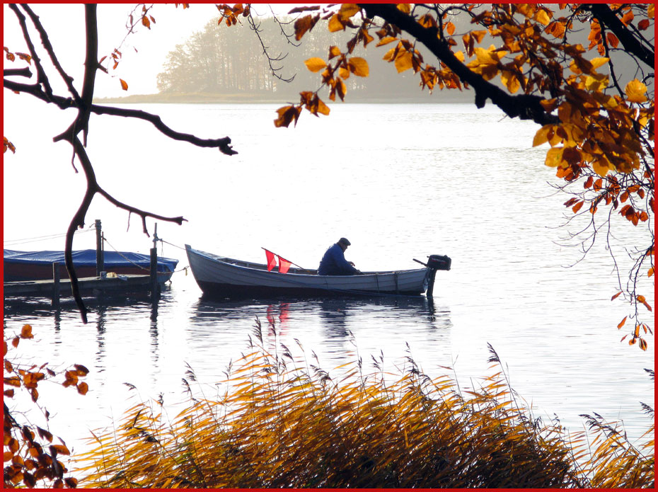 Autumn time   and a fishermantending his boat 930x695