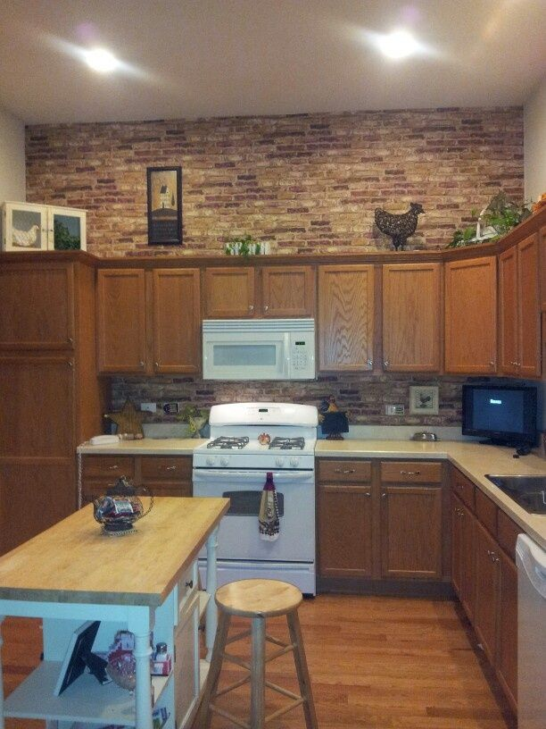 This homeowner used some brick paper in her kitchen It blends well 612x816