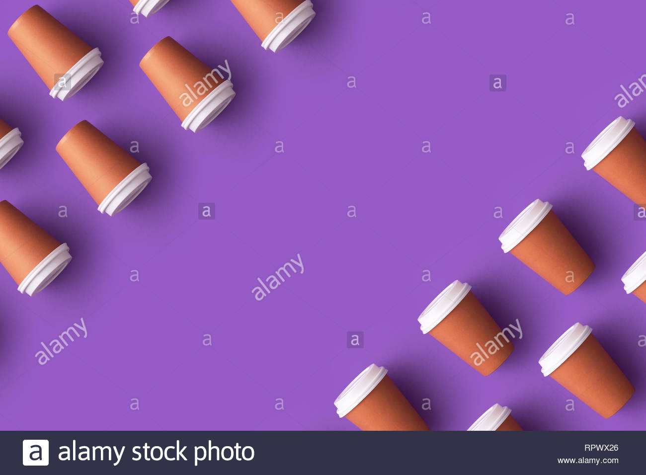 Multiple disposable coffee cups organized over purple background 1300x956