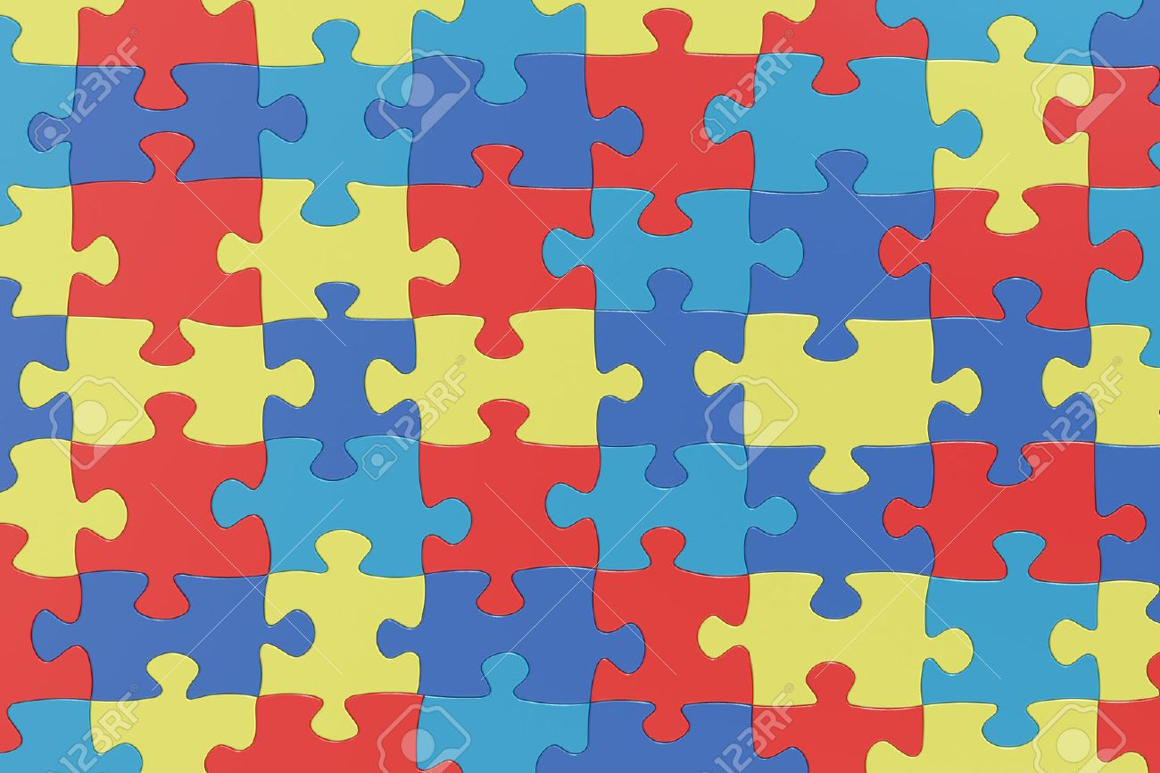 Puzzle Pieces In Autism Awareness Colors Background 3D Rendering 1300x866