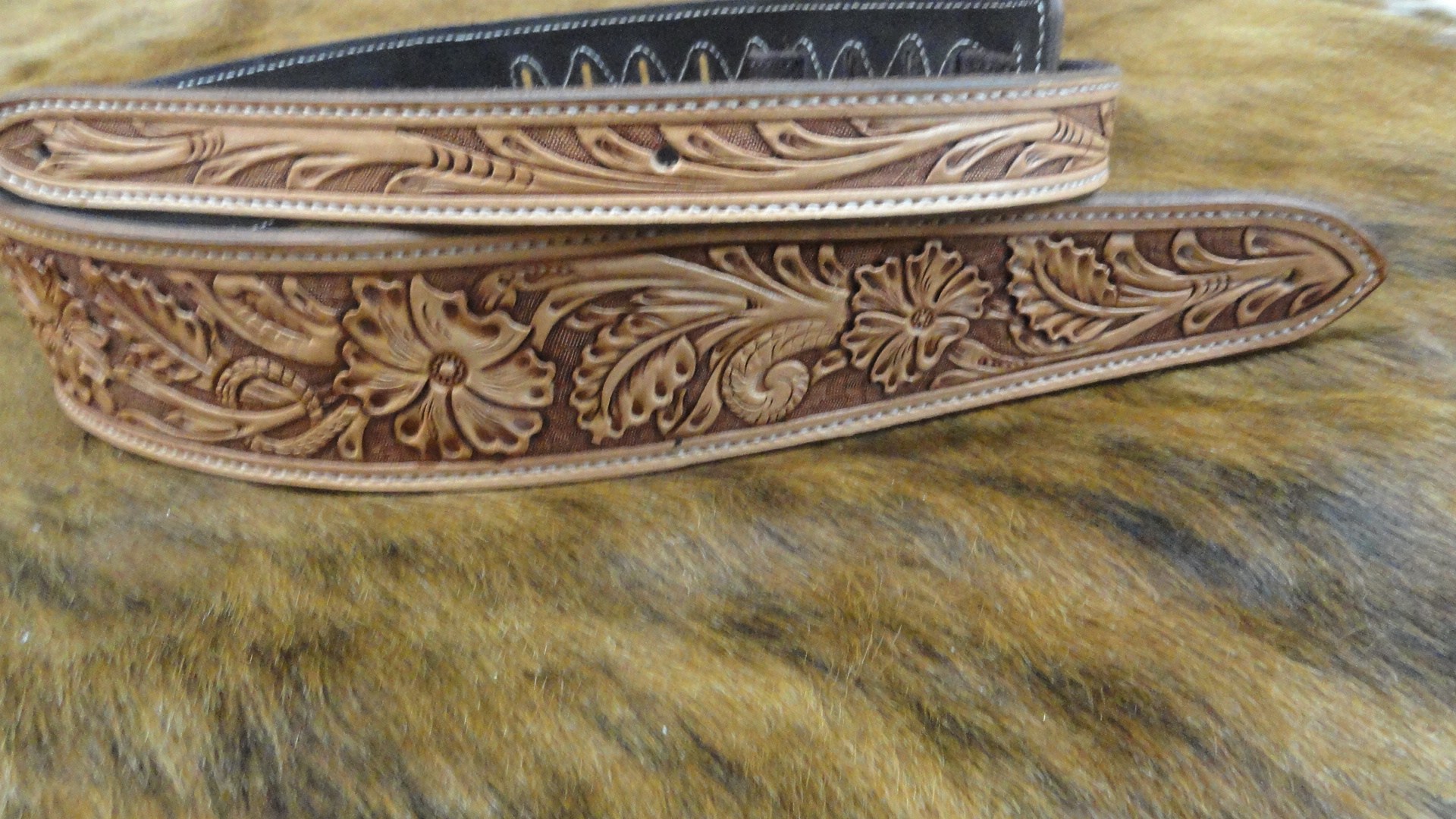 Hand tooled with antique stain 75 C 1920x1080