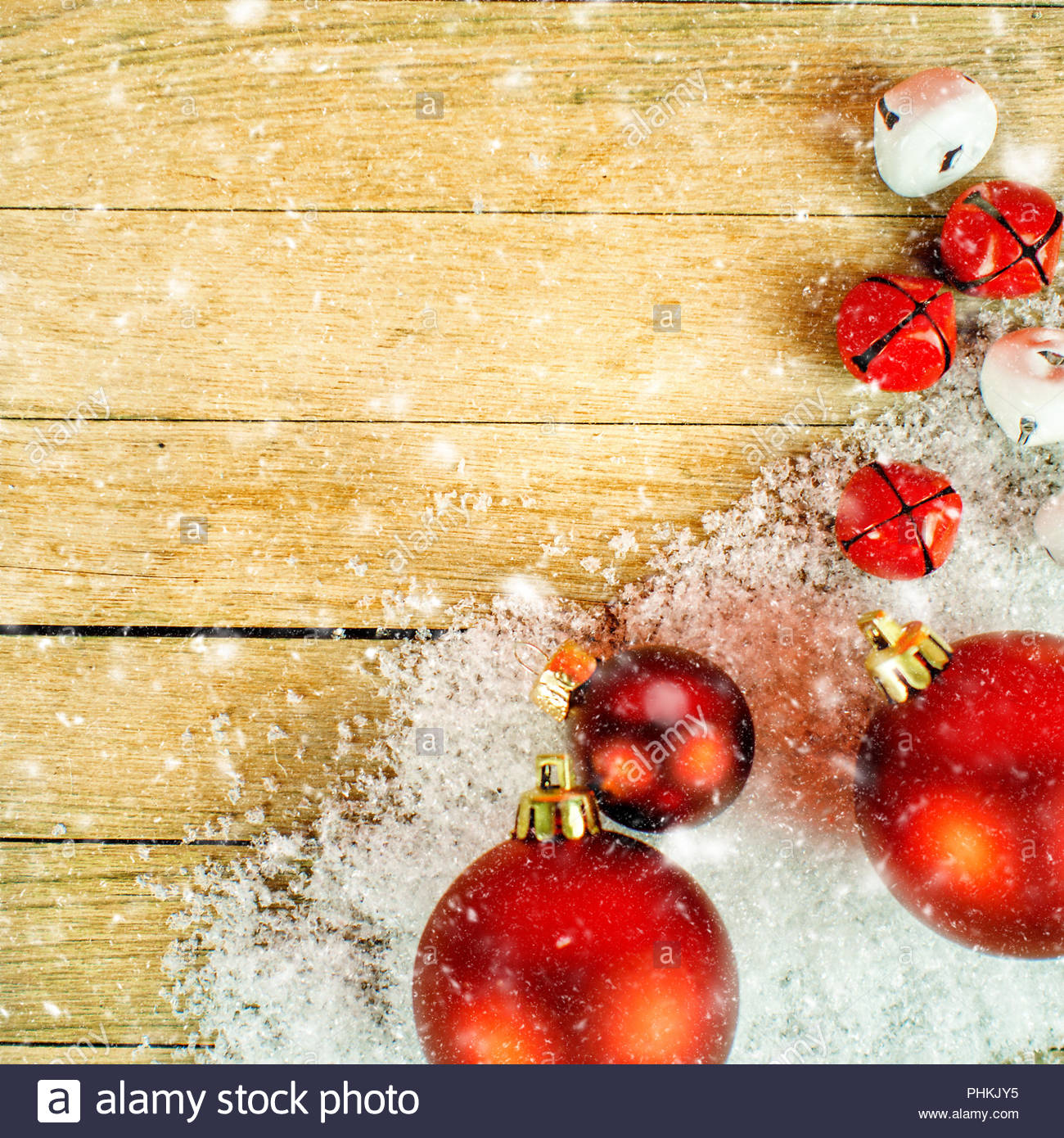 closeup of Christmas decoration with snow falling on wooden 1300x1390