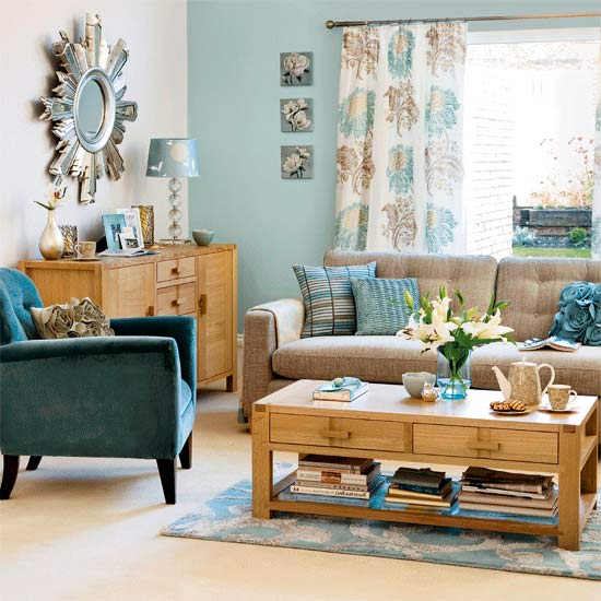 living room with featured wallpaper blue carpet modern sofa cream 550x550
