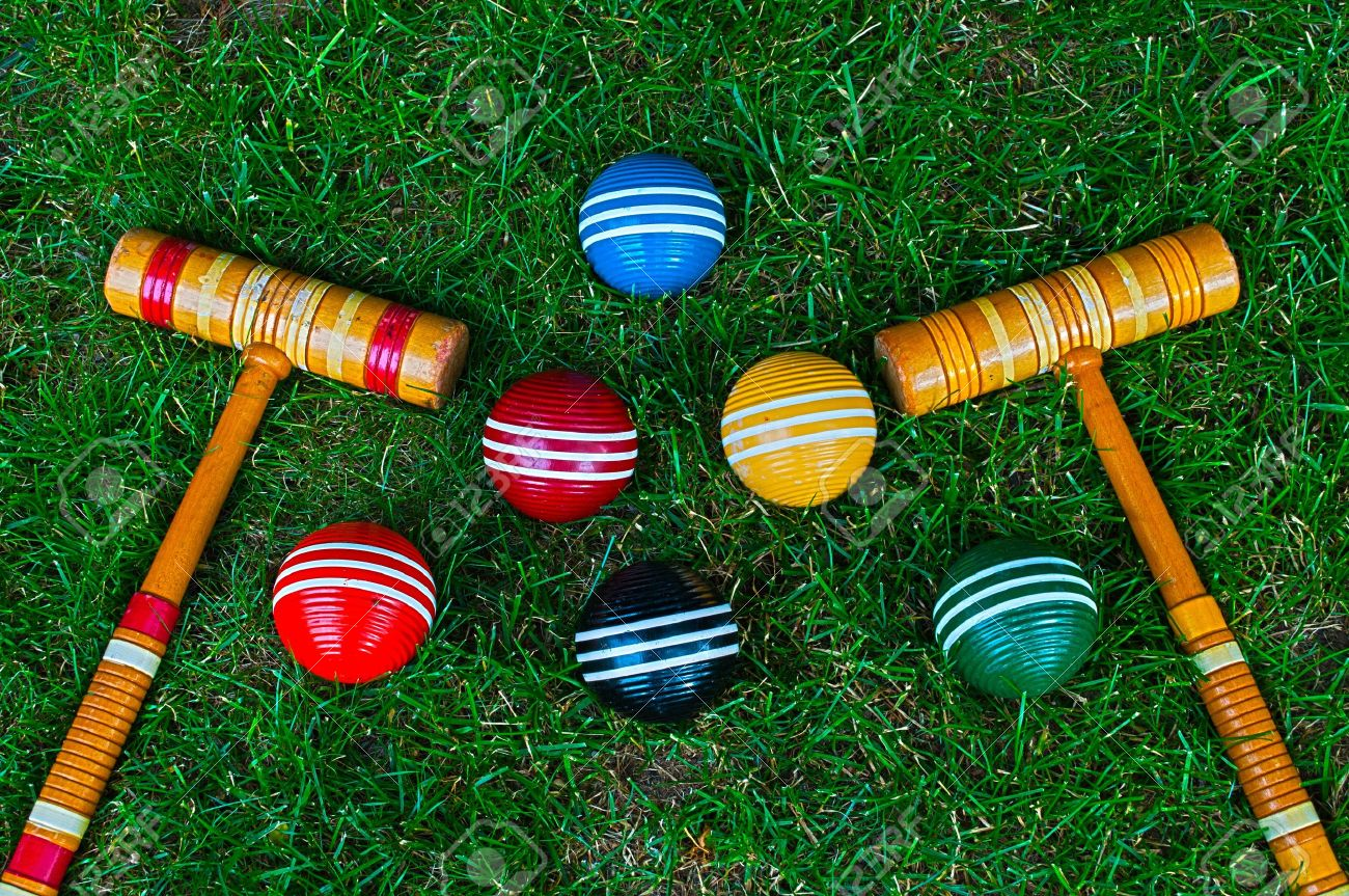 Croquet Mallets And Balls On Grass Background Stock Photo Picture 1300x863