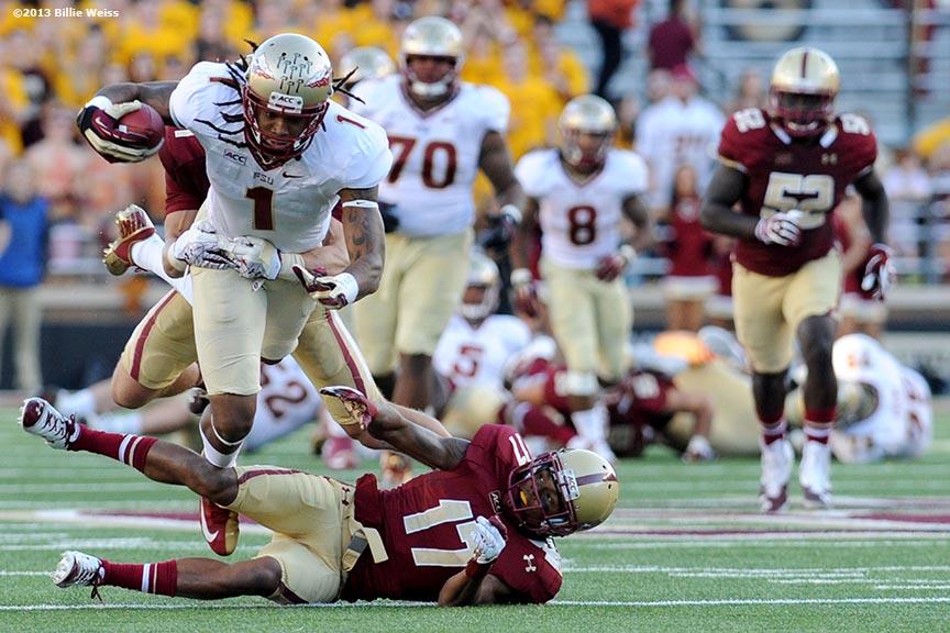 Florida State Seminoles wide receiver Kelvin Benjamin leaps over 864x576
