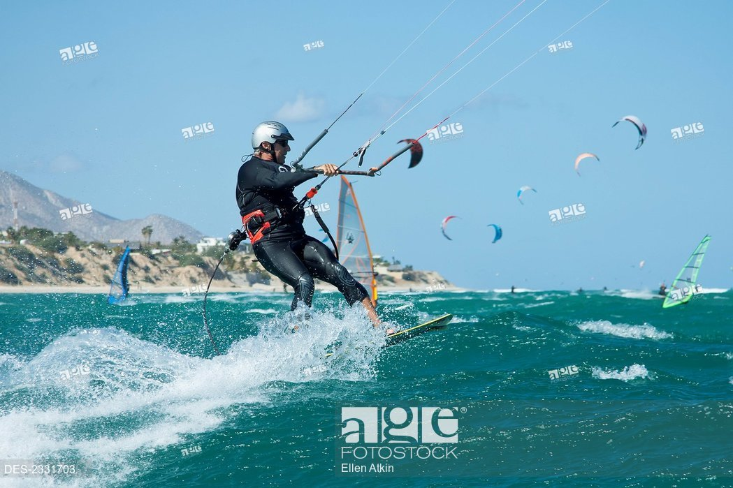 Mexico others in background La Ventana Mature man kiteboarding 1049x699