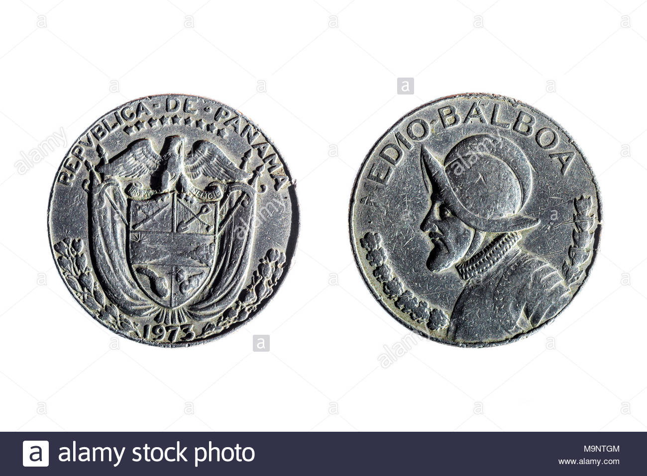 front and back of panamanian coin of half balboa on white 1300x957