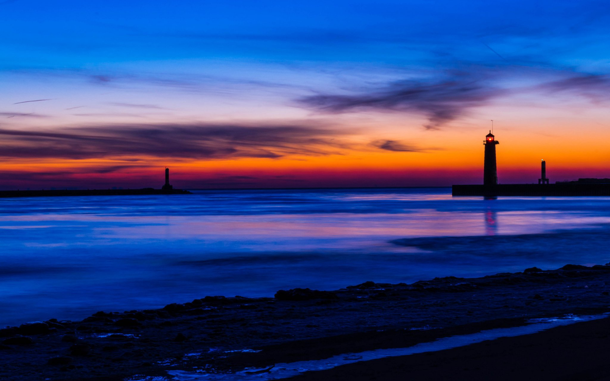 beach lighthouse night orange sunset blue sky clouds wallpapers 2048x1281