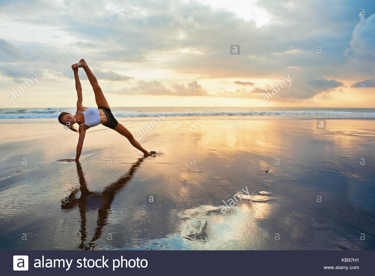 Meditation on sunset sky background Young active woman in yoga 1300x956