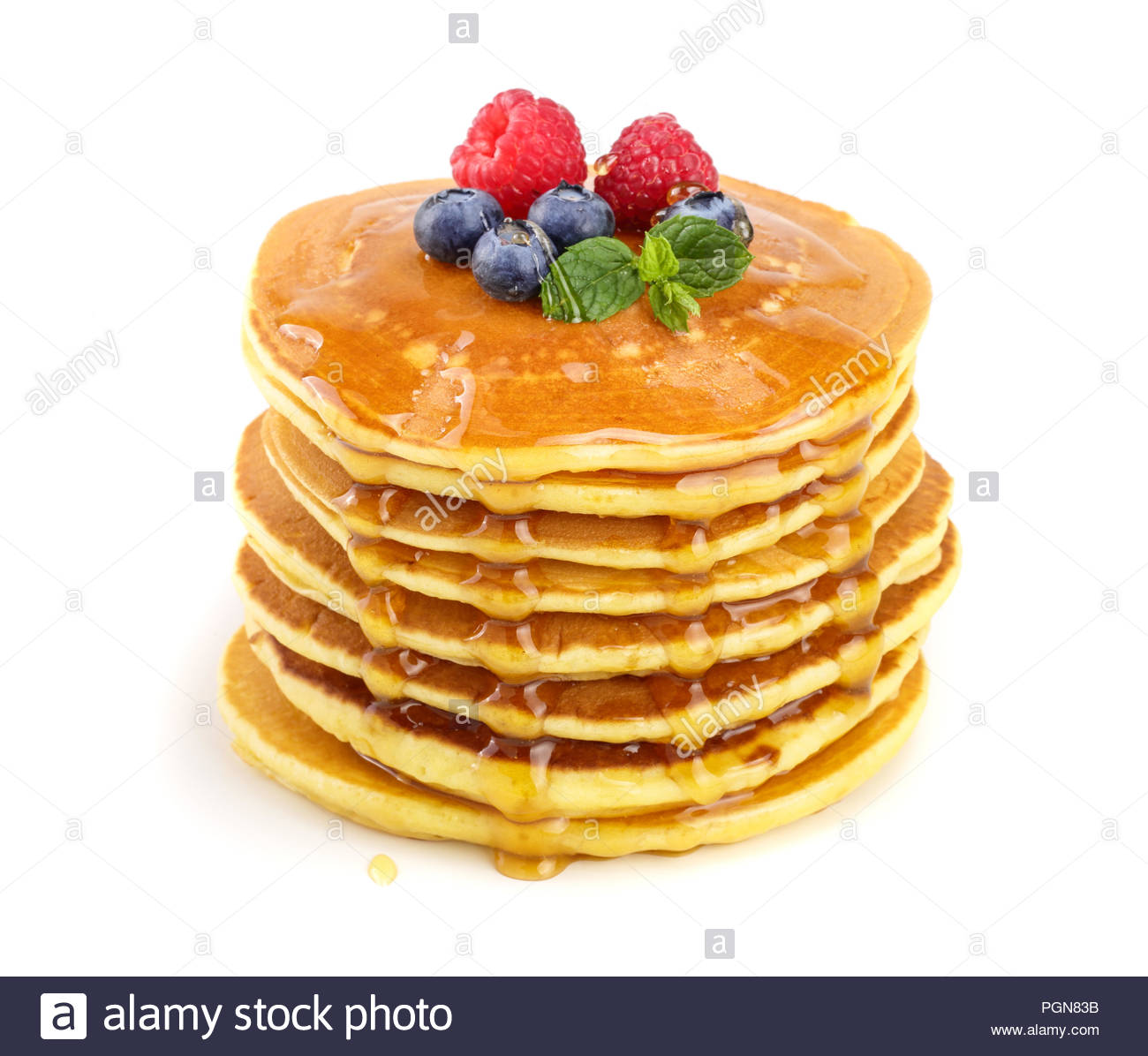Pancakes stack with different berries and honey isolated on white 1300x1196