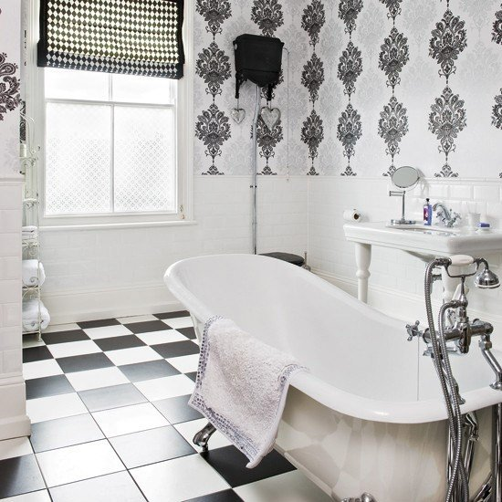 Monochrome bathroom with tiled floors freestanding bath sink and 550x550