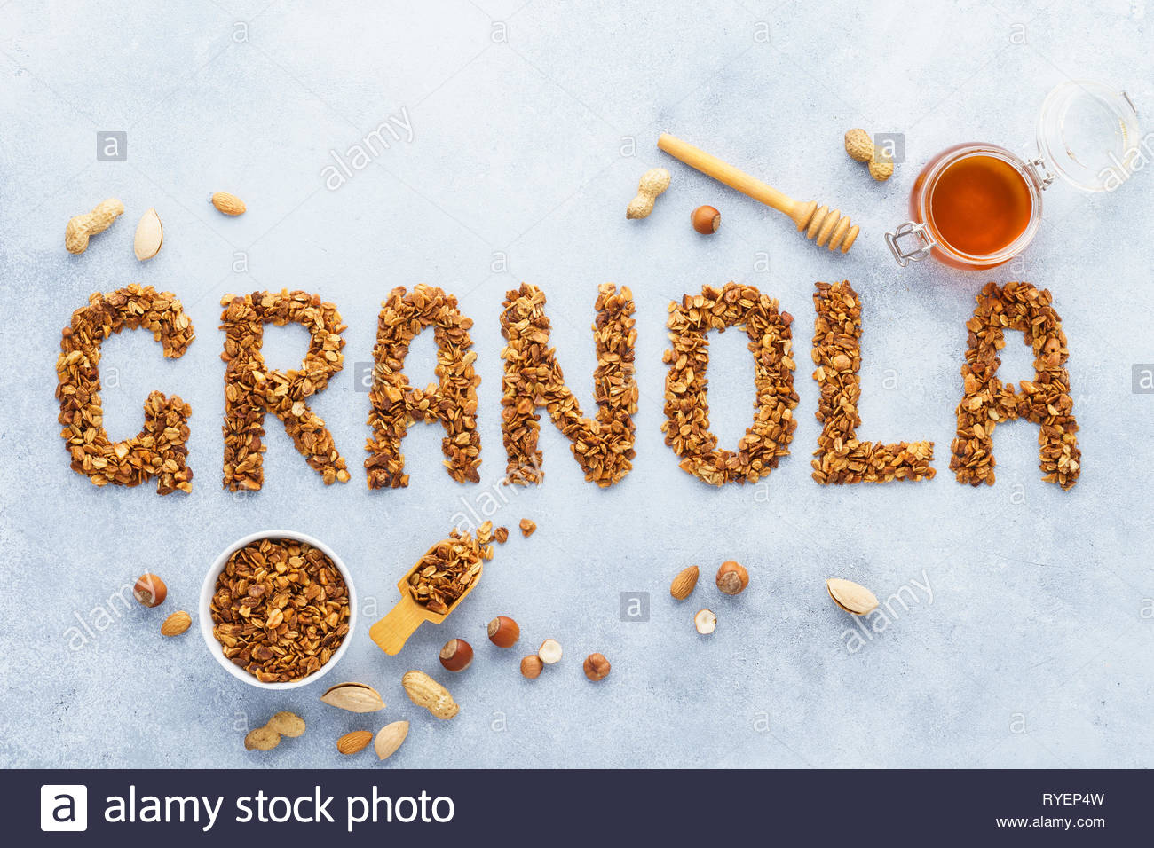 Healthy oat nuts and honey granola background Word granola made 1300x956