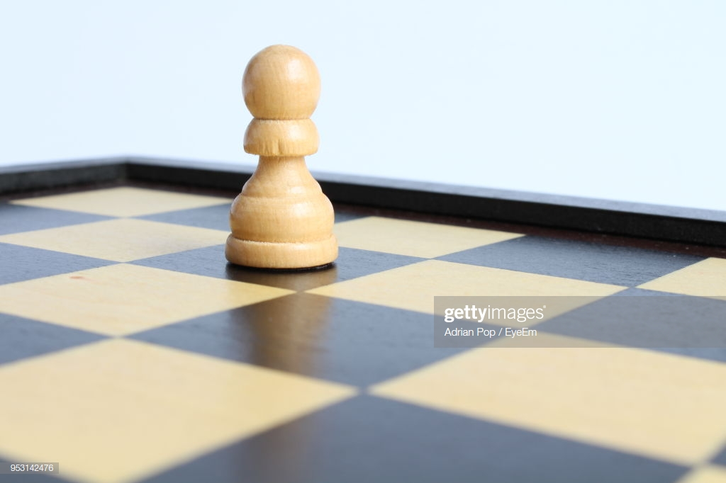 Closeup Of Pawn On Chess Board Against White Background Stock 1024x682