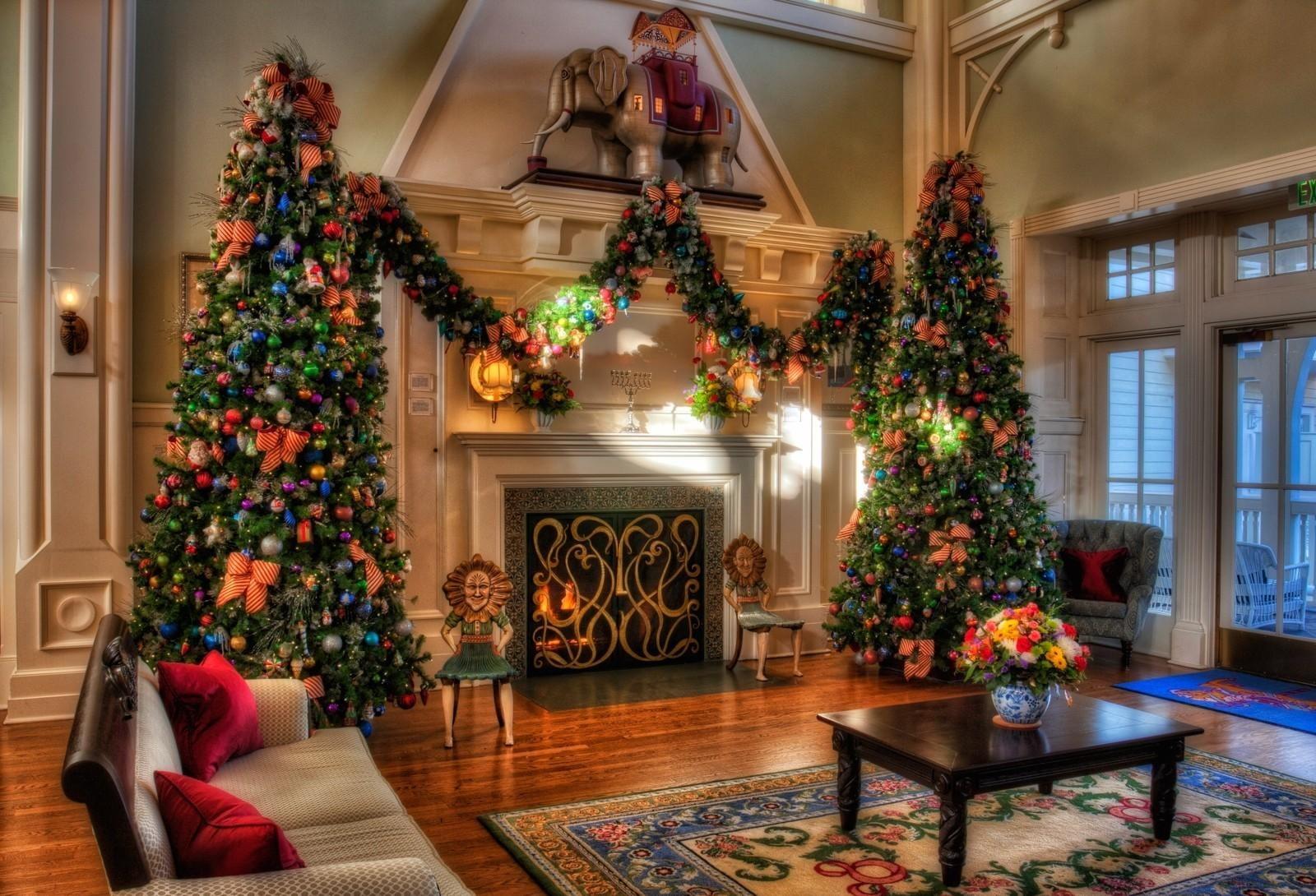 Two giant green christmas tree beside fireplace HD wallpaper 1600x1090