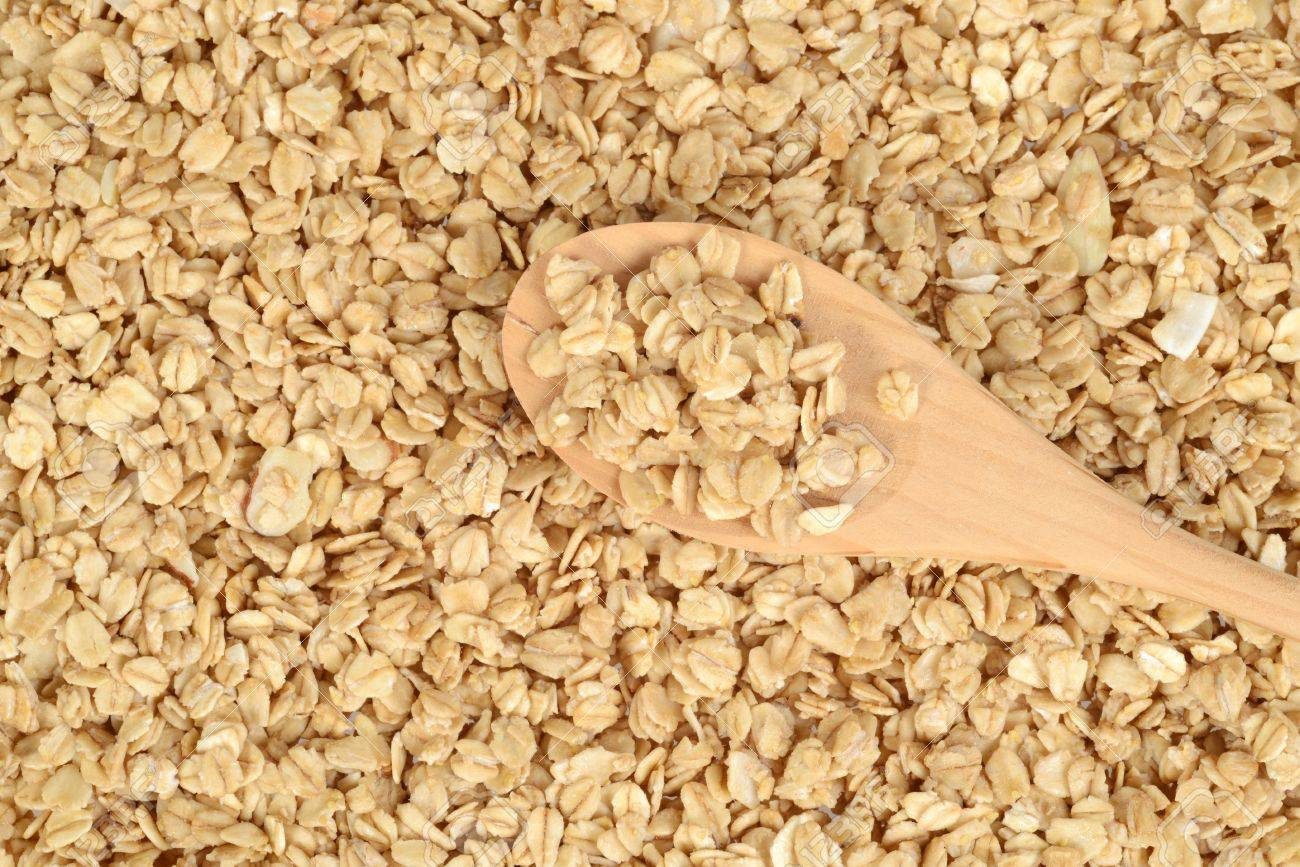 Granola Background With Wood Spoon Stock Photo Picture And 1300x867