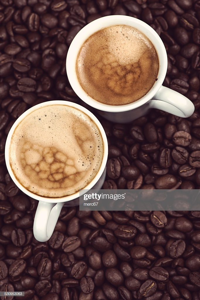 Fresh Creamy Expresso Over Roasted Coffee Beans Background Stock 683x1024