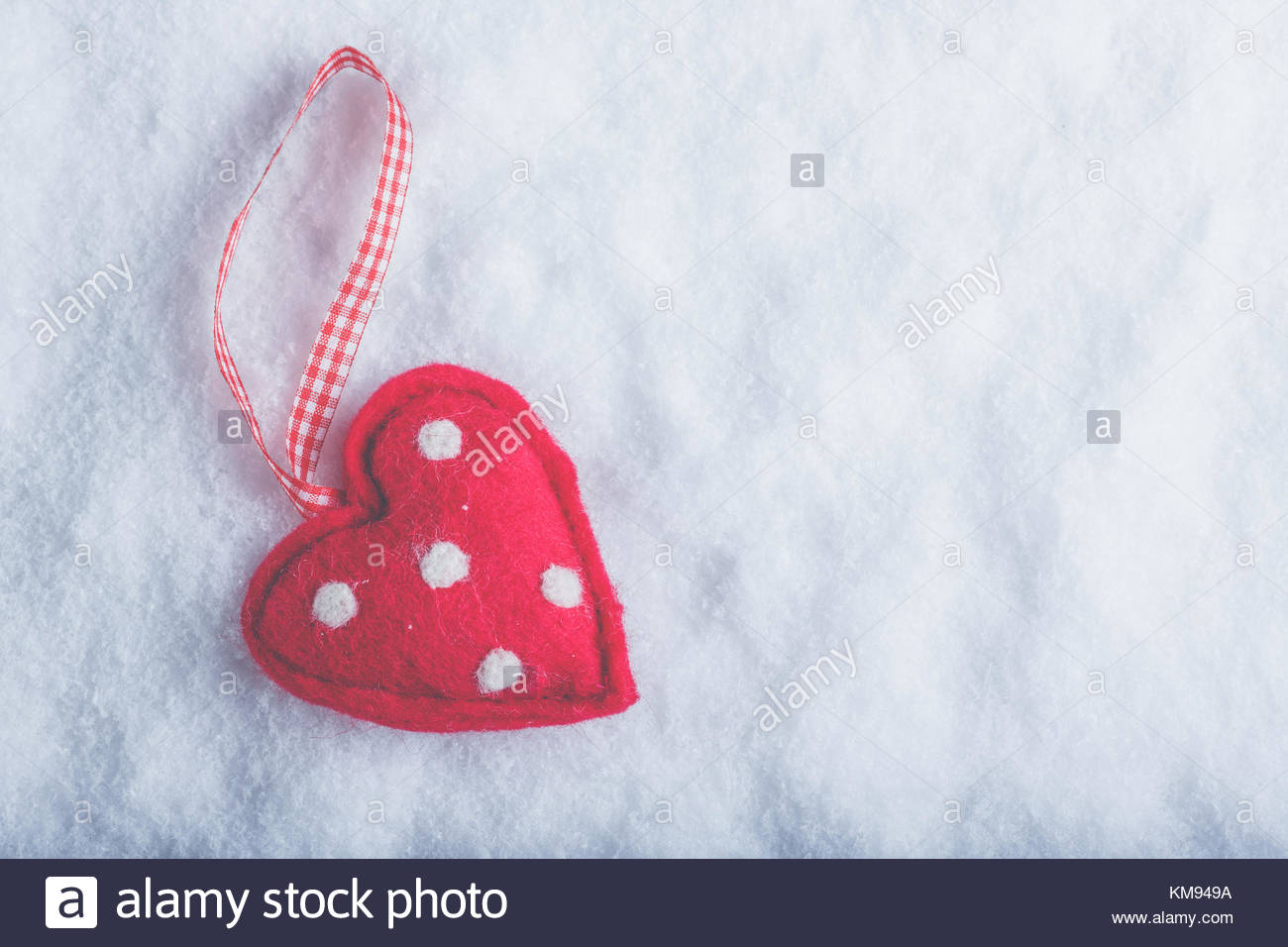 Red toy suave heart on a frosty white snow winter background Love 1300x956