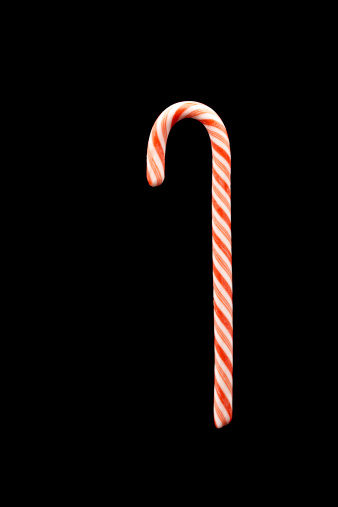 Christmas Candy Cane On A Black Background Stock Photo Getty Images 338x507