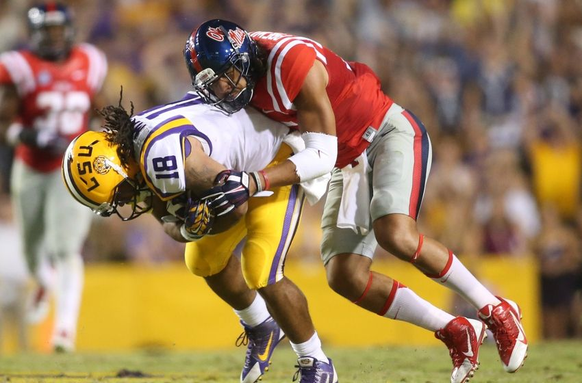 LSU Tigers running back Terrence Magee 18 is tackled by Mississippi 850x560