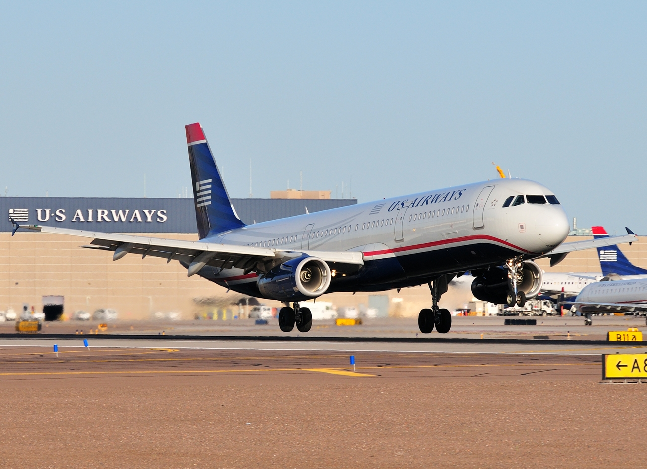 Airbus A321 200 of US Airways While Rotating Takeoff Aircraft 1300x944
