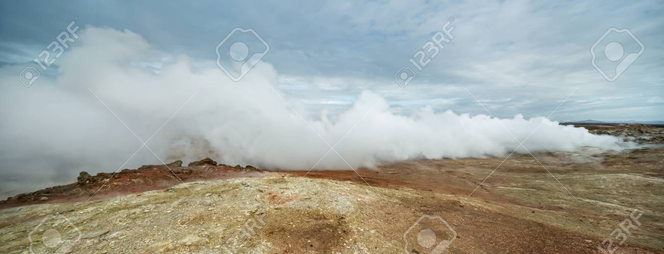 Geothermal Geyser Is Steaming On The Background Of The Cloudy 1300x499