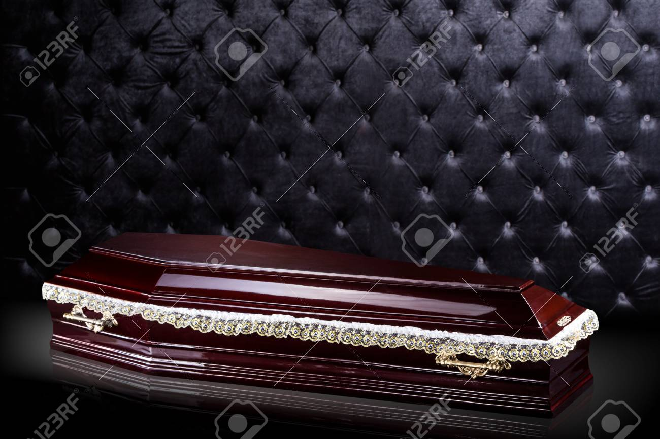 Closed Wooden Dark Brown Coffin Isolated On Gray Luxury Background 1300x866