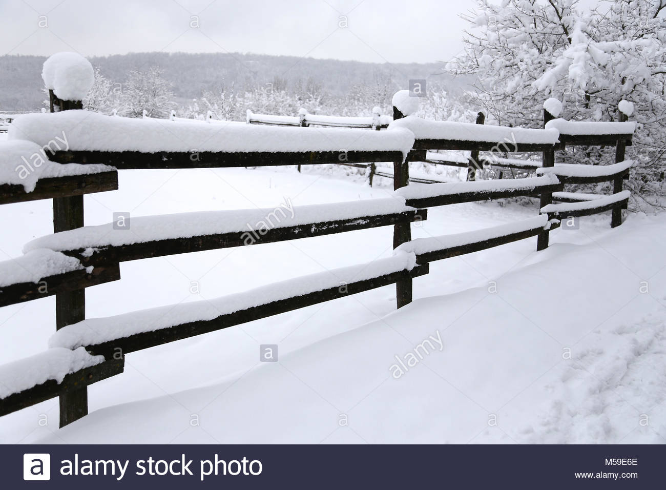 Snowy corral fence wintertime as a background Stock Photo 1300x956