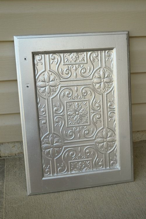 turn out great thomay try it Faux Tin Tile wallpaper on Cabinets 500x751