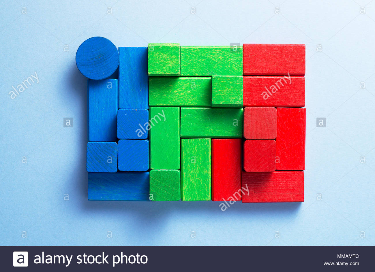 Colorful wooden cubes organized over blue background top view 1300x944