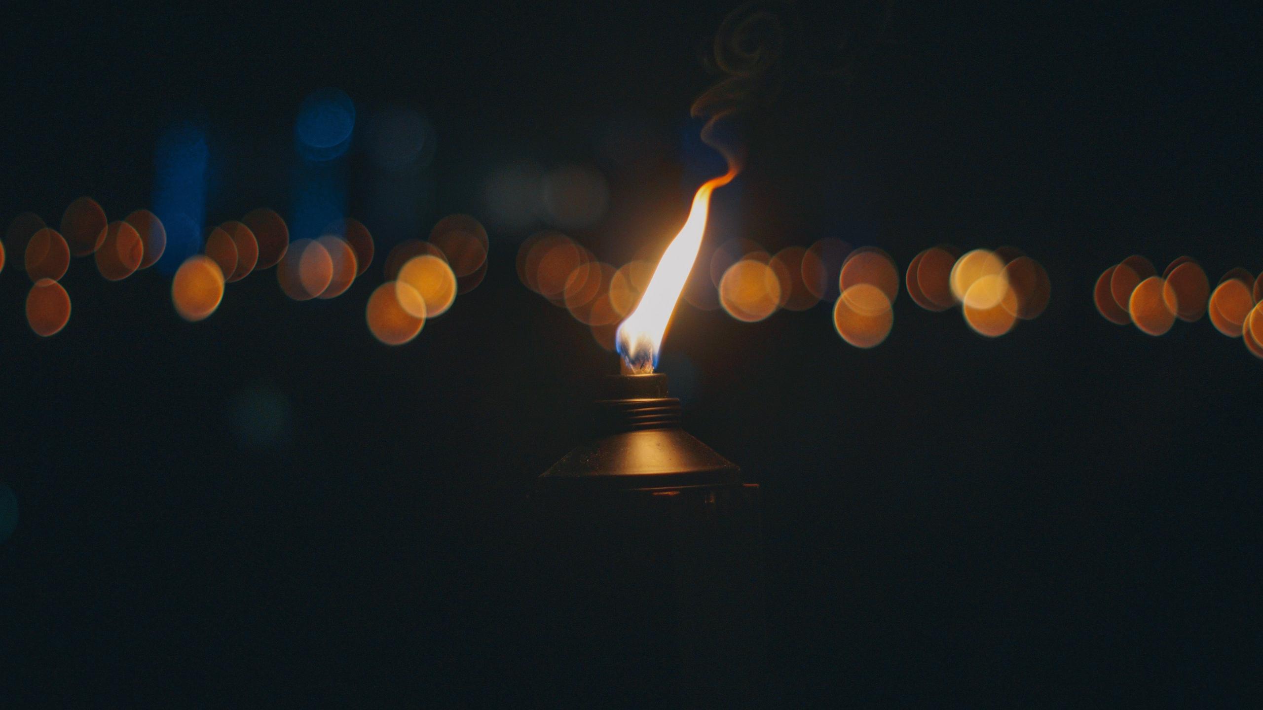 Download wallpaper 2560x1440 torch fire wick glare widescreen 2560x1440