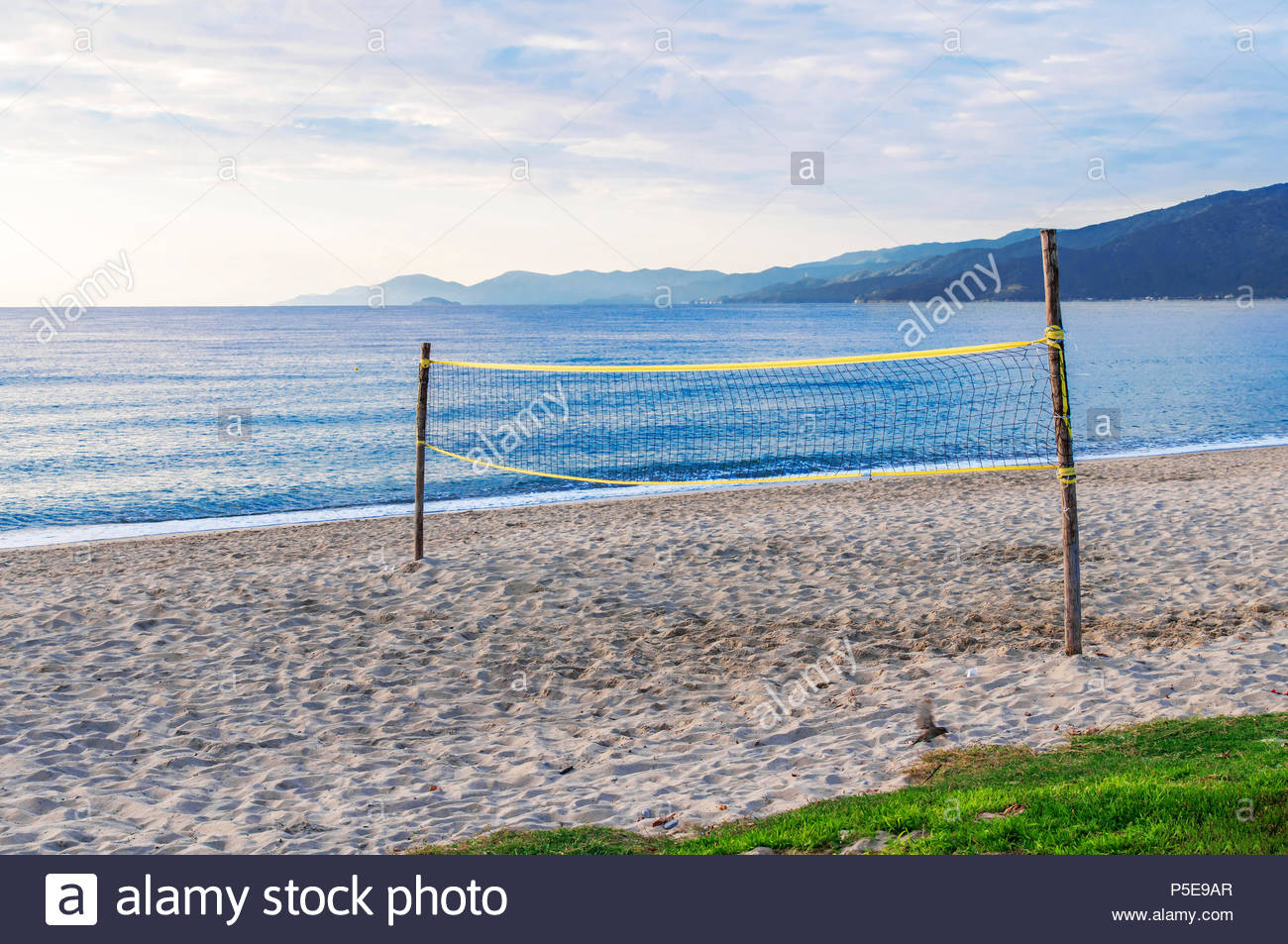 Beach volley court with sea background Stock Photo 209912383   Alamy 1300x953