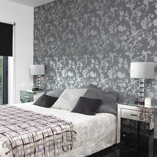 Bedroom with patterned wallpaper Bedroom designs Glass lamps 550x550