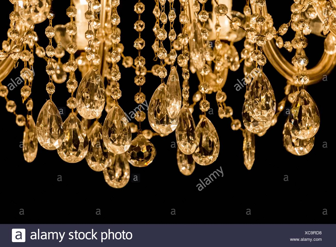 gallant chandelier with light candles and dark background Stock 1300x956