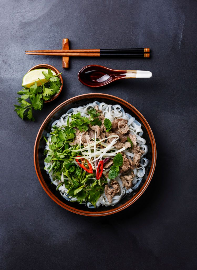 Pho Bo vietnamese Soup with beef on dark background Gourmet Art 750x1024