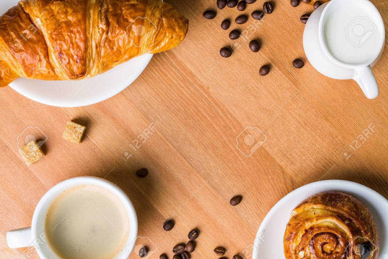 Coffee Cup With Milk Jug Cinnabon And Croissant On Wooden 1300x866