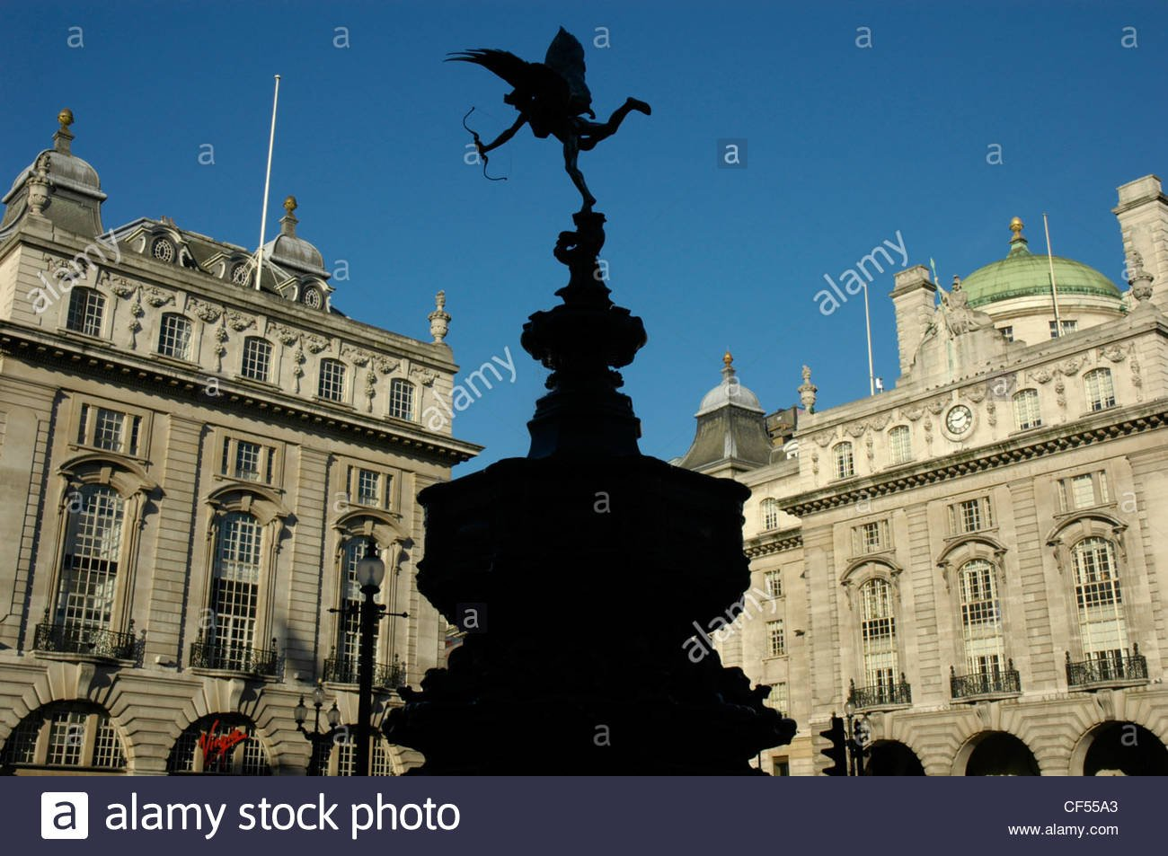 Silhouette of the Eros statue with victorian buildings in the 1300x953