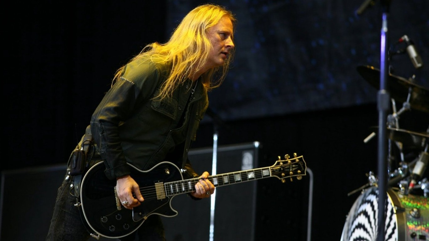 Download wallpaper 1366x768 jerry cantrell hair guitar play 1366x768