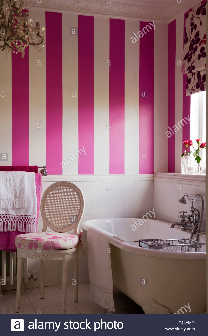 Freestanding bath tub in bathroom with striped wallpaper and 863x1390