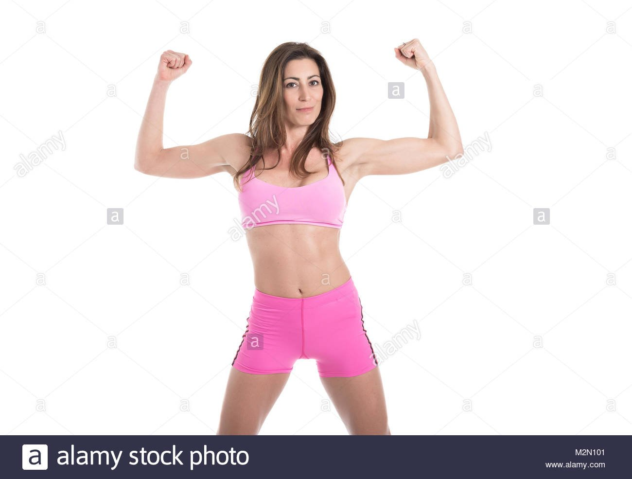 Strong muscular woman flexing his arms Fit and healthy woman on 1300x985