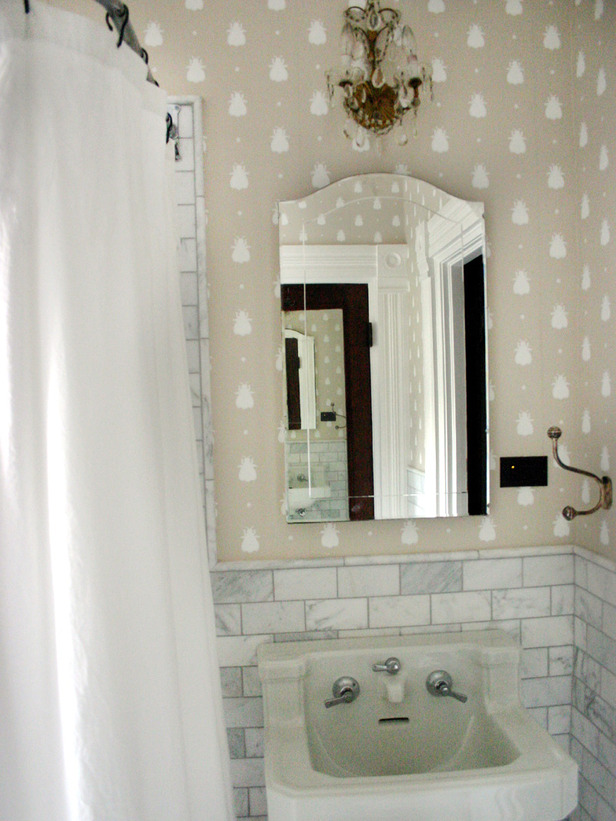Kids Bathroom With Subway Tile Walls and Fun Wallpaper 616x821