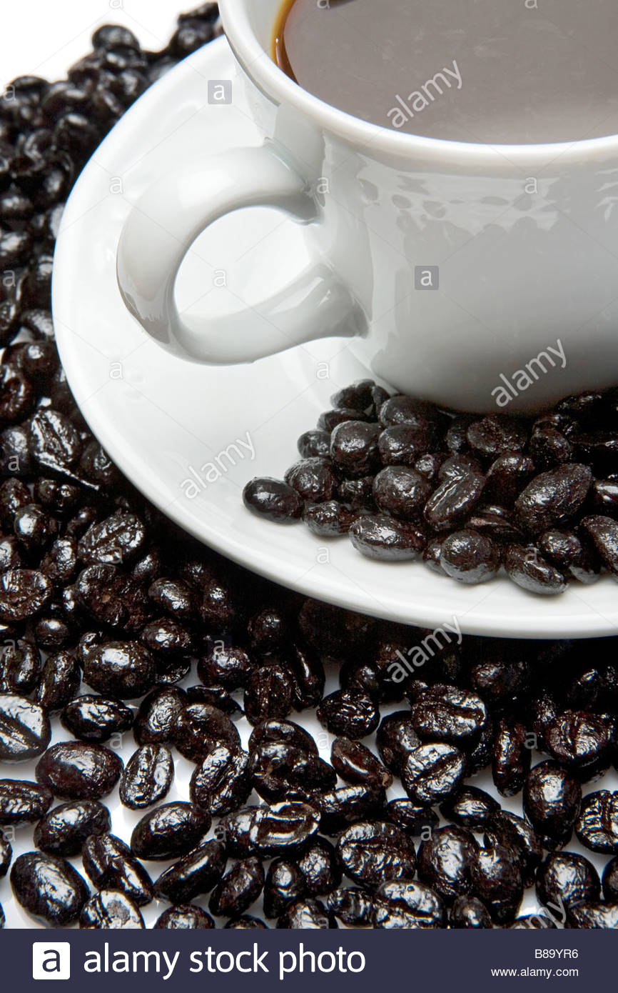 Cup of expresso coffee on a over white background Stock Photo 866x1390