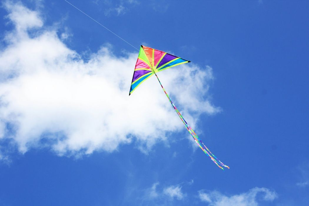 Kite flying bokeh flight fly summer hobby sport sky toy fun 1050x700